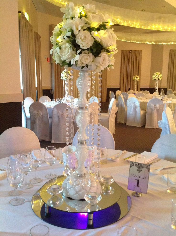Gorgeous all white centrepiece for wedding reception. www.houseofthebride.com.au