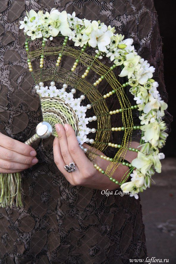 A floral fan can be an interesting alternative for bridesmaids. We have made them in the past for an art deco themed wedding. We think this one is by a Russian florist called Olga and it's loved by Jemini Flowers, Oxford - www.jemini.co.uk