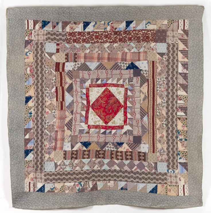 Date: 1865 - 1875  This multicoloured frame quilt features a Turkey Red Paisley print central square set on point