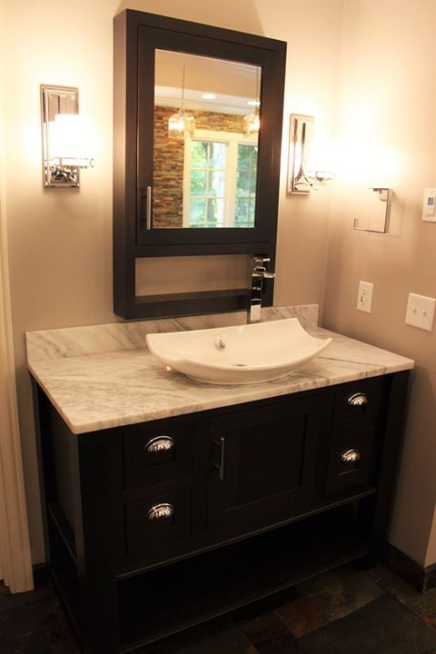 Dura Supreme Furniture style cabinets and a Kohler Leaf sink