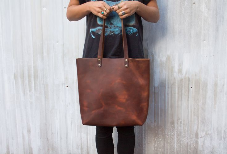Hand sewn tote with rustic oil tanned leather. Available on ETSY.