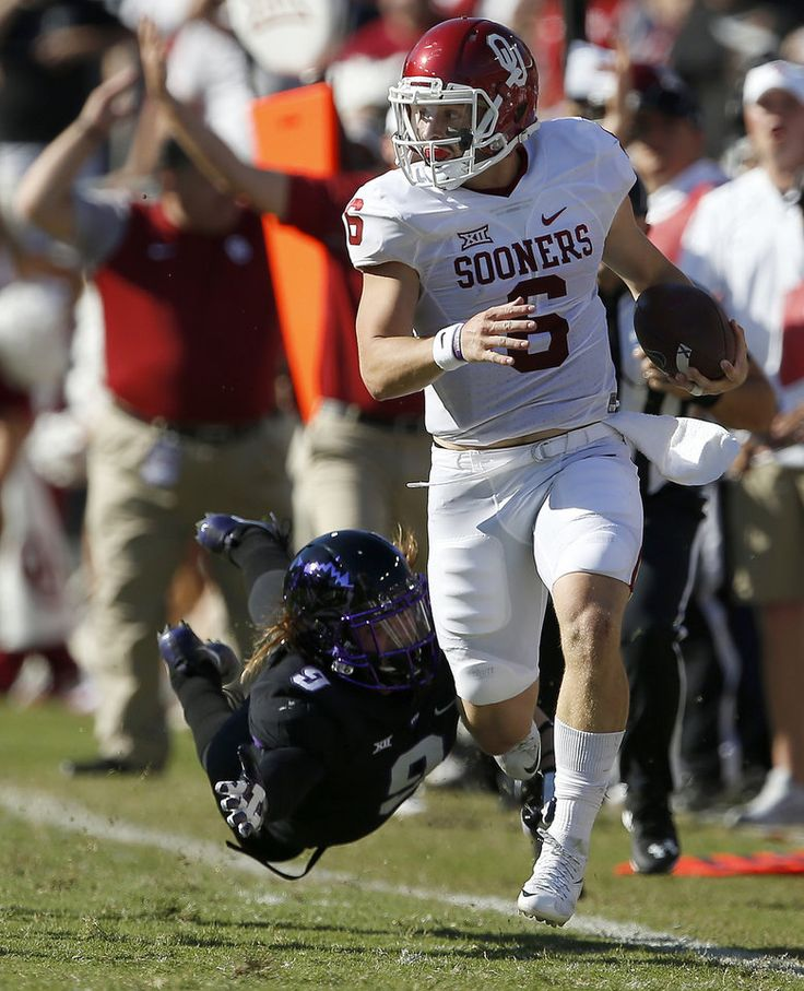 Oklahoma's Baker Mayfield (6) runs past TCU's Mat Boesen (9) before the play was called back for holding during a college football game between the University of Oklahoma Sooners (OU) and theTCU Horned Frogs at Amon G. Carter Stadium in Fort Worth, Texas, Saturday, Oct. 1, 2016. Oklahoma won 52-46. Photo by Bryan Terry, The Oklahoman