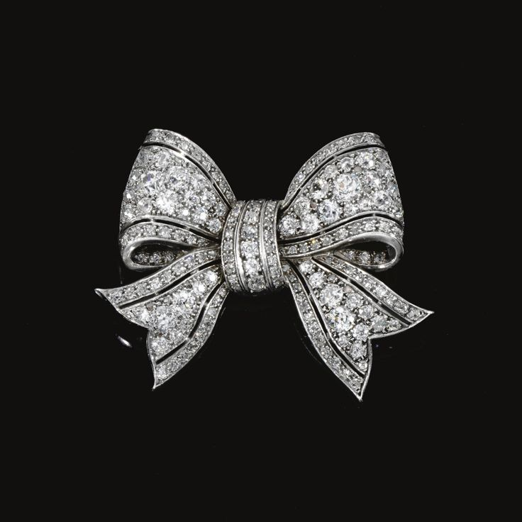 DIAMOND BOW BROOCH, EARLY 20TH CENTURY Designed as a bow, pierced and set with circular-, single-cut and rose diamonds.