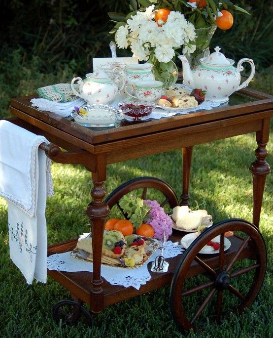 Tea Time under the shade tree, don't you just love it!  We have this little cart in storage!!
