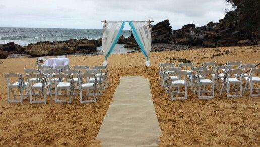Beach wedding ceremony,starfish arch,hessian runner