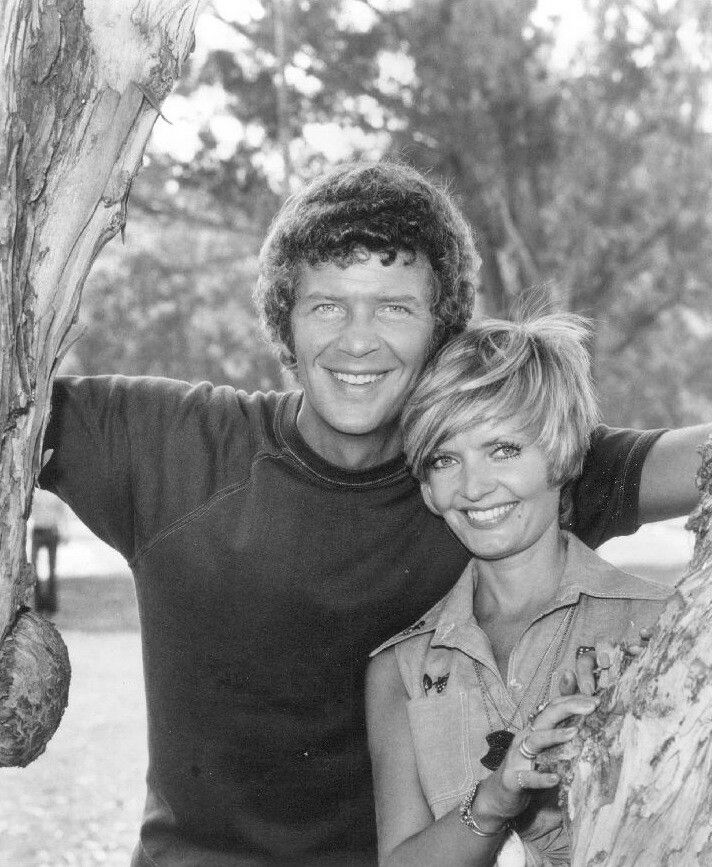 Robert Reed and Florence Henderson as Mike and Carol Brady