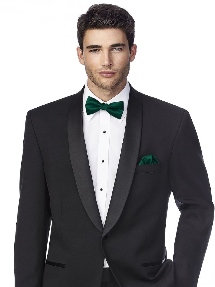 This is an example of the grooms/groomsmen attire. They will be in black tuxedos with green bow ties that are the exact color as bridesmaid dresses. They will not be wearing pocket squares. Would like them to have white boutonnieres above the pocket. Any green on the boutonniere should not clash with the dark/rich hunter green bow tie.