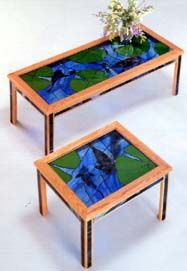 "Design by Mark Waterbury A 16 3/8""x 44 1/4"" coffee table or 20 1/4""x 15 7/8"" end table rectangular fish panel with different sizes of koi swimming beneath blue water and lily pads. Tabletops are constructed with plating technique, which glues the fish underneath the glass for more depth realism. This project is constructed with copper foil. Pattern in back issue can be enlarged, or full-size pattern #8 is available. Back issue CD or Digital version only."