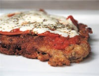 Milanesa Napolitana - Argentinian Fried Steak topped with a piece of ham, tomato sauce and melted mozzarella cheese. A favorite at my house!