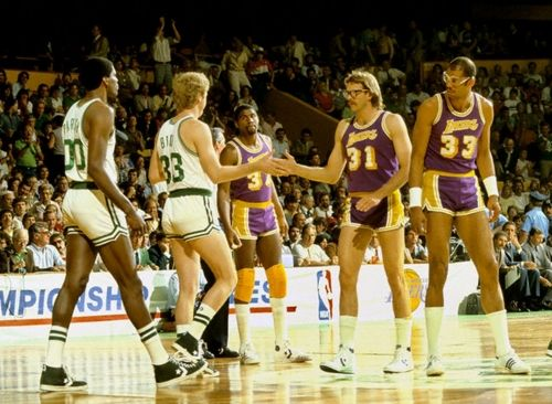 Lakers Celtics get ready for the opening tip. Look at Magic and Bird eyeballing each other.