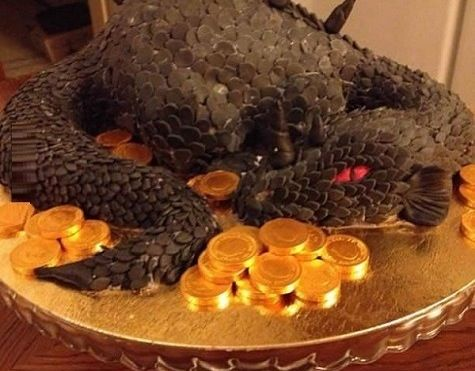Dragon Cake. Cocoa-dusted almond slices for scales, I wonder?