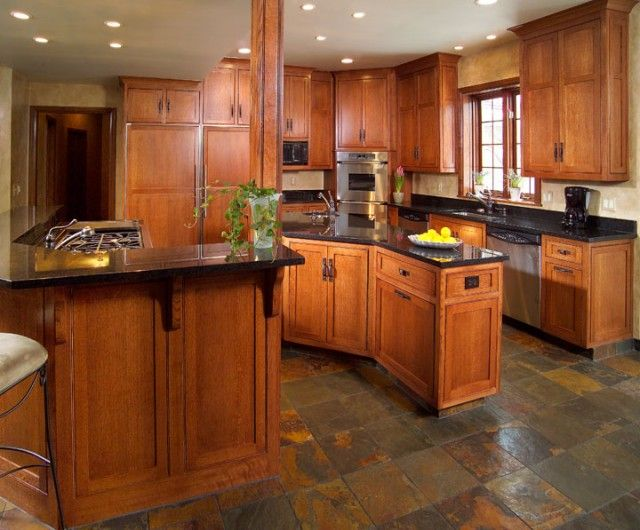 Craftsman style kitchen: Honey maple cabinets, dark counters, slate floors