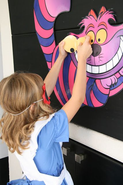 Pin the pieces on Cheshire Cat Alice in Wonderland Tea Party Birthday Game..i would pin the smile.