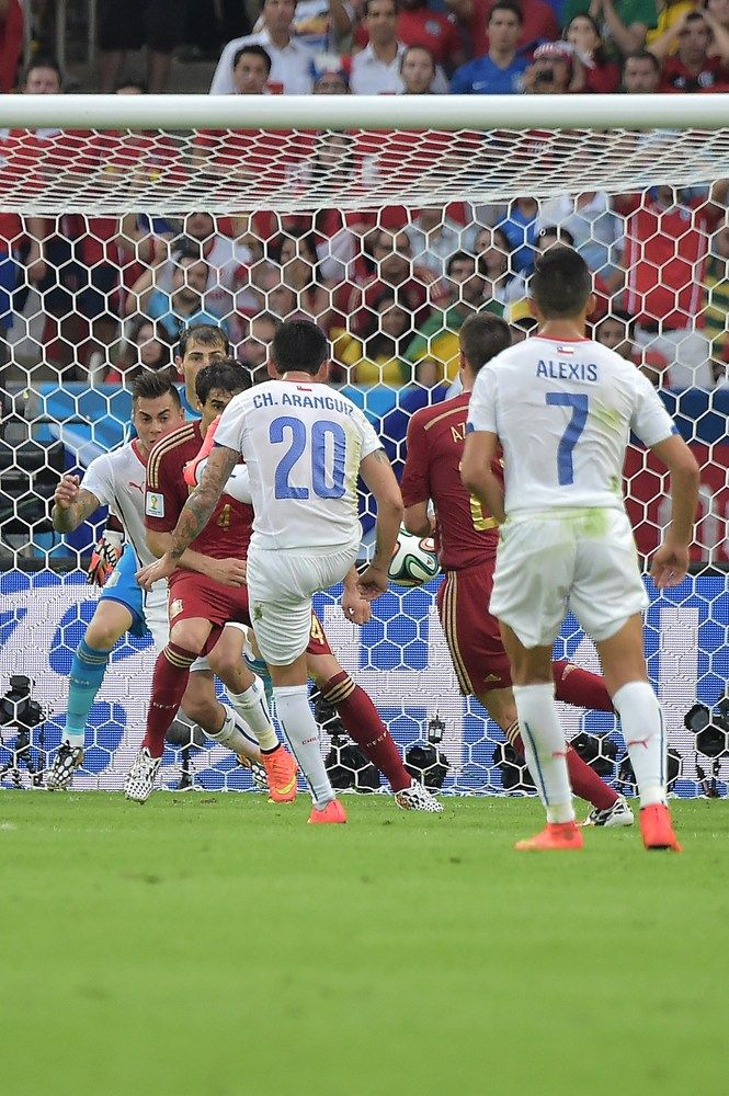 Spain Eliminated From World Cup With Devastating Loss To Chile - Chile's midfielder Charles Aranguiz (20) strikes to score a goal during a Group B football match between Spain and Chile in the Maracana Stadium in Rio de Janeiro during the 2014 FIFA World Cup on June 18, 2014.