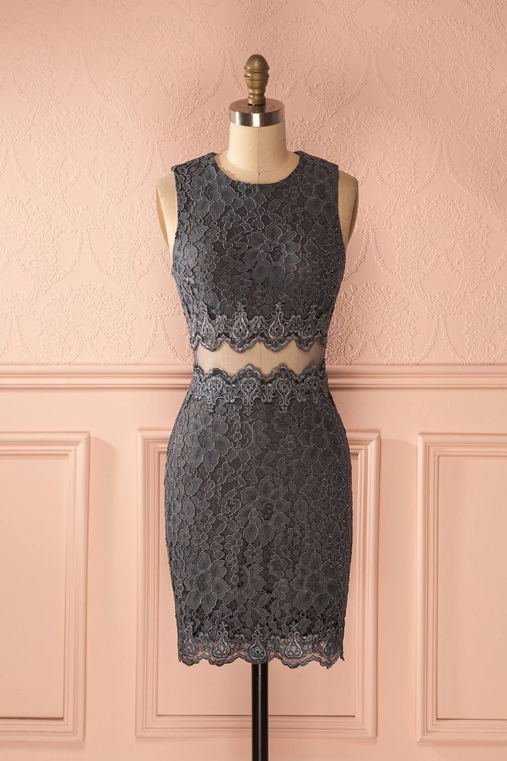 Ses yeux gris comme l'acier luisaient sous la lumière tamisée.  Her eyes, grey like steel, gleamed in the dim light. Blue grey floral lace dress https://1861.ca/products/velanise