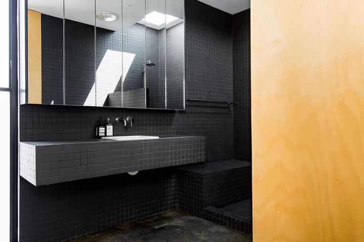 peeping through to the triangle house bathroom - no glass and a whole lotta black matte mosaics 📷 @dionrobeson #trianglehouse #mtlawley…