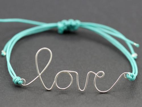 Use a paperclip and jewelry pliers to make this. Try Names.