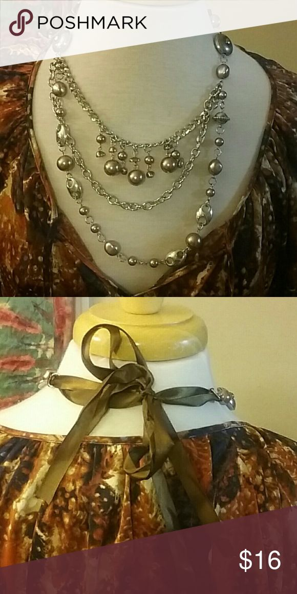 Multimedia Brown Bow Necklace Strands of silver and brown on silver chain,  with a brown bow closure at the back.   Great condition!!! 💥💥💥  All reasonable offers considered.  Use the offer button Jewelry Necklaces