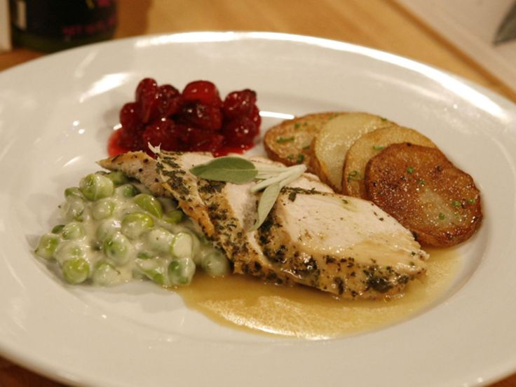 Get this all-star, easy-to-follow Herbed Turkey Breast in Gravy with Creamed English Peas and Cranberry Compote recipe from Robert Irvine