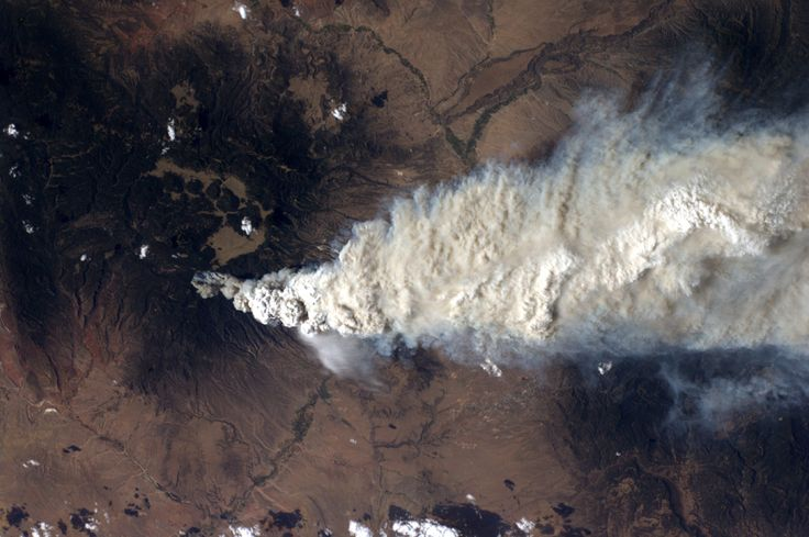 A NASA image taken by a crew member aboard the International Space Station, flying at an altitude of approximately 235 statute miles on June 27, 2011, shows the Las Conchas fire in the Jemez Mountains of the Santa Fe National Forest in north-central New Mexico. The fire is just southwest of Los Alamos National Laboratories. (NASA/Associated Press)