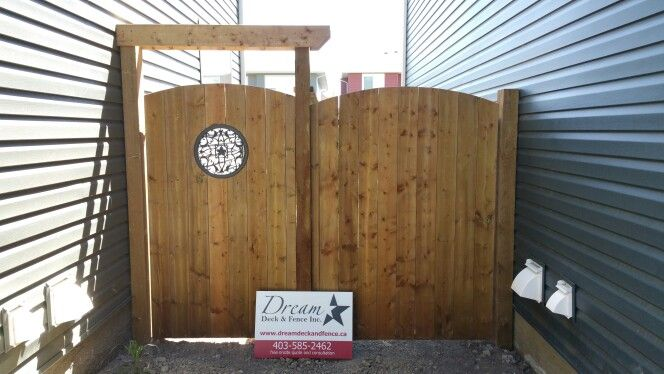 Brown Presssure Treated Wood gates one with black cast aluminum insert and simple arbour on top to add structure support so your gate doesn't ever sag and it looks great too.......www.dreamdeckandfence.ca