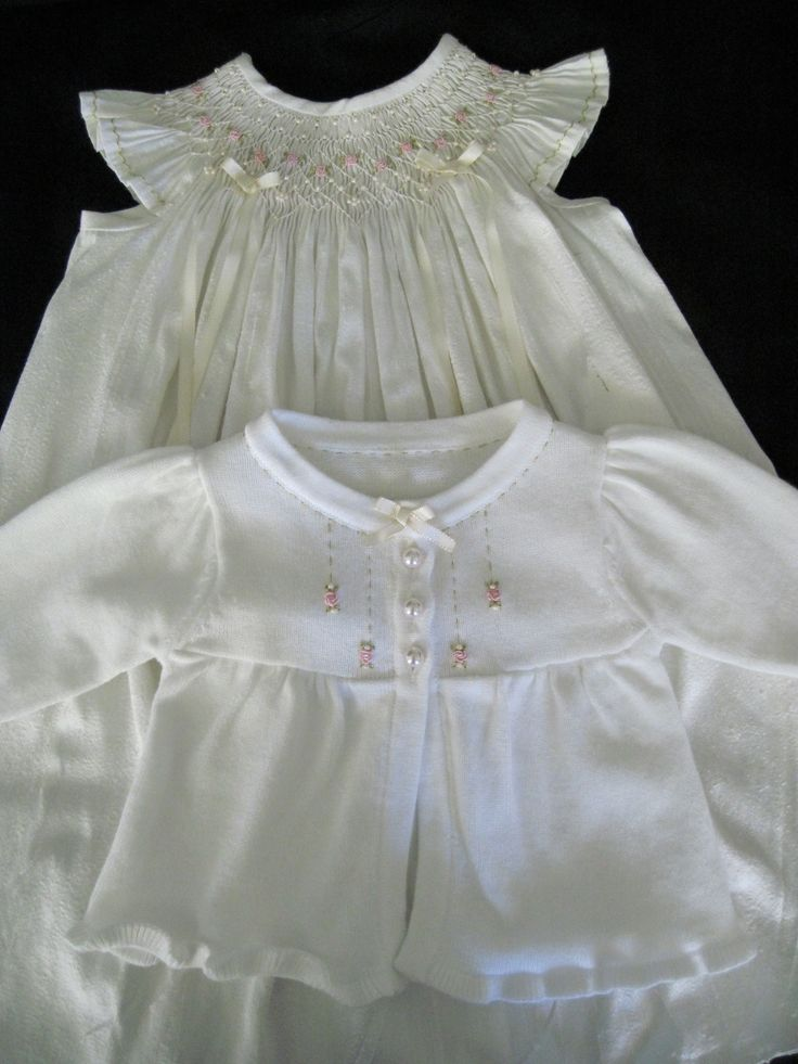 beautiful smocked gown with matching embroidered sweater.