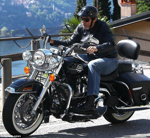 George Clooney enjoying a ride on his Harley on the hills of Italy in the city of Como.