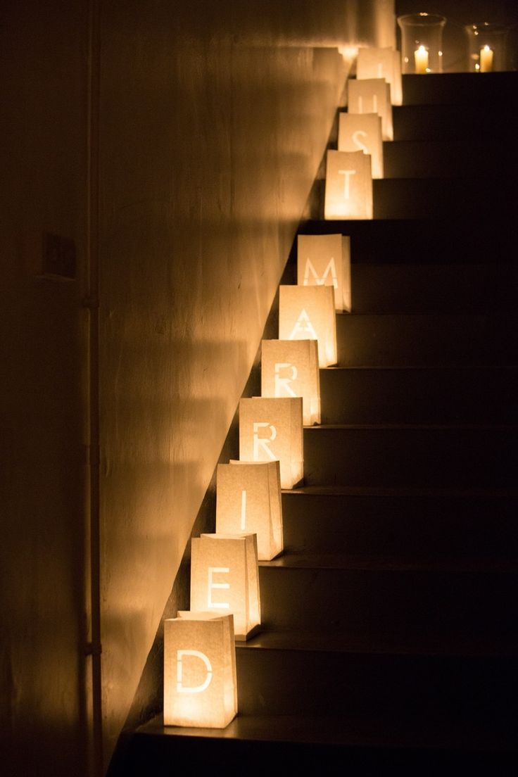 Simple wedding decor using tea lights & paper bags to line the stairs creating a gorgeous evening effect