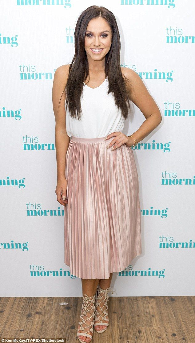 Cute outfit: The brunette was filling her regular weekly slot of Showbiz Gossip...