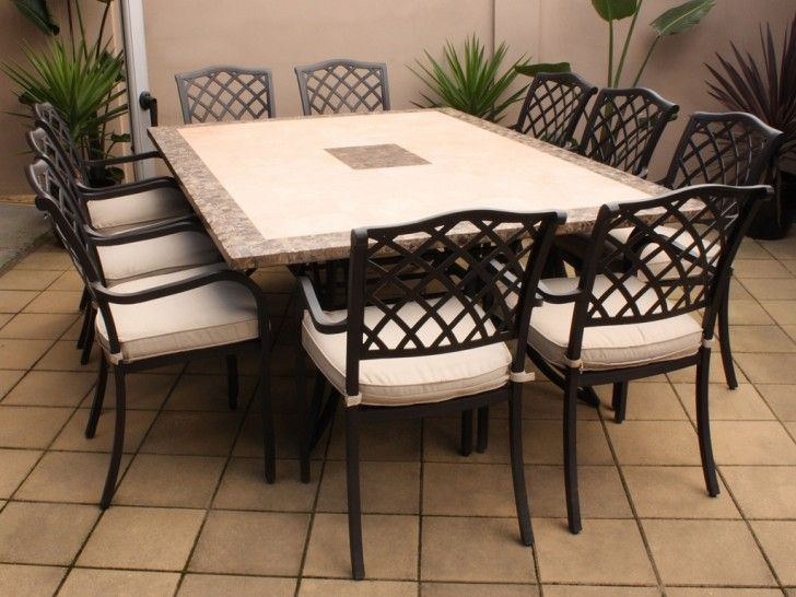 Furniture: Soft Brown Vinyl Floor Natural Lighting Outdoor Dining Room White Upholstered Chairs Black Paint Metal Material Four Legs Strong Base Large Rectangle Shape Dining Table Outdoor Plants: Superb Outdoor Furniture in Beautiful Place