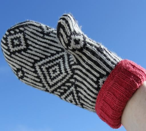 A dramatic, yet elegant, pair of mittens, inspired by a traditional African woven pattern and turned into an ultra-warm mitten fabric by an English knitter in Nova Scotia!