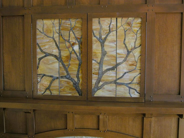 Original branches panels in a custom entertainment unit. Original design by Kelly Haggard Olson. All Rights Reserved.