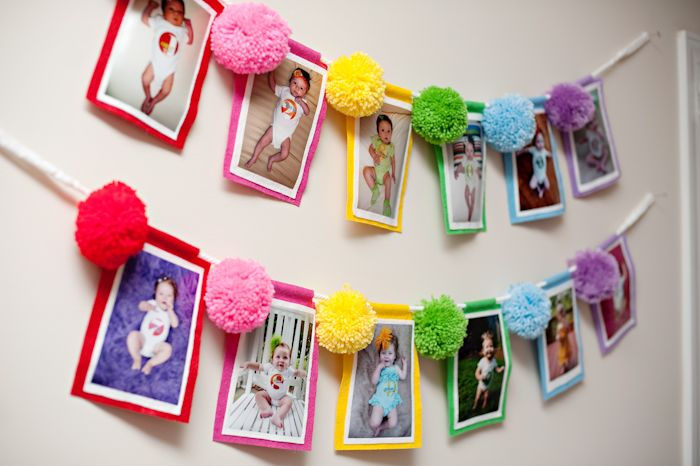 This is a cute idea for a first birthday party! Make a banner with 12 pictures, one from birth to age 1.