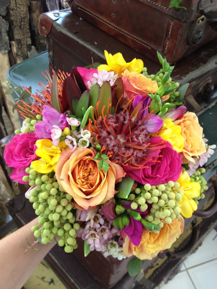 Fun and funky brides maids bouquets  -Designed & Made by Rahenna -Flowers used.. Roses, Freesias, Wax Flower, Leucadendrons, Natives & Gum Foliage