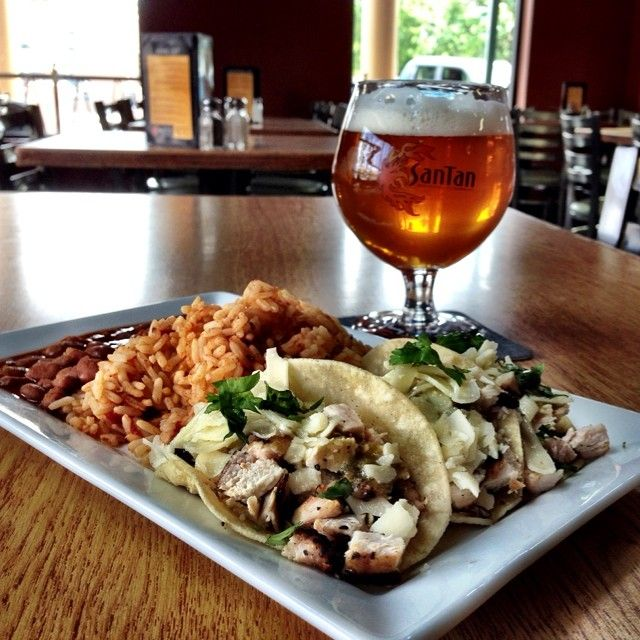 SanTan Mini Chicken Tacos: 3 mini tacos filled with grilled marinated chicken, cabbage + salsa verde topped with aged cheddar. Served with Spanish rice and rancho beans paired with our MoonJuice IPA.