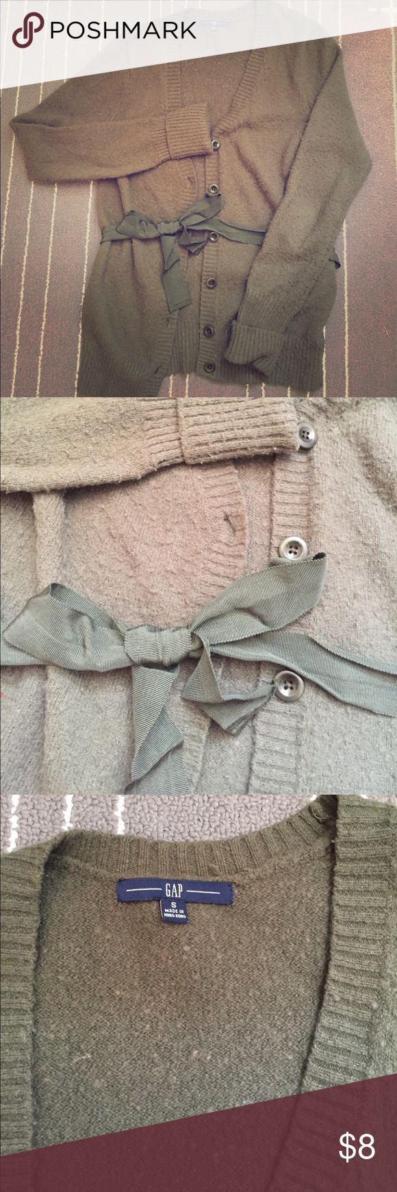 Olive green Gap cardigan with ribbon tie Soft and cozy olive green cardigan from Gap with v neck and buttons down with ribbon tie at waist. Falls hip height. Size small. GAP Sweaters Cardigans
