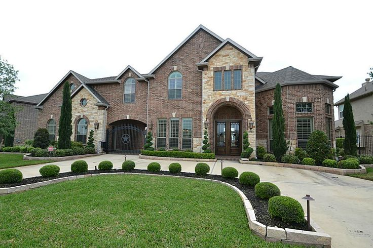 Fantastic home with a circular drive backing to the lake located at 27102 Wooded Canyon Dr.