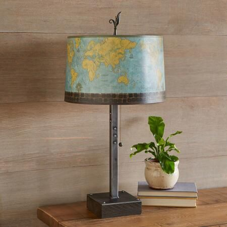 From sundancecatalog com · global village table lamp inspired by her extensive collection of globes massachusetts artist janna