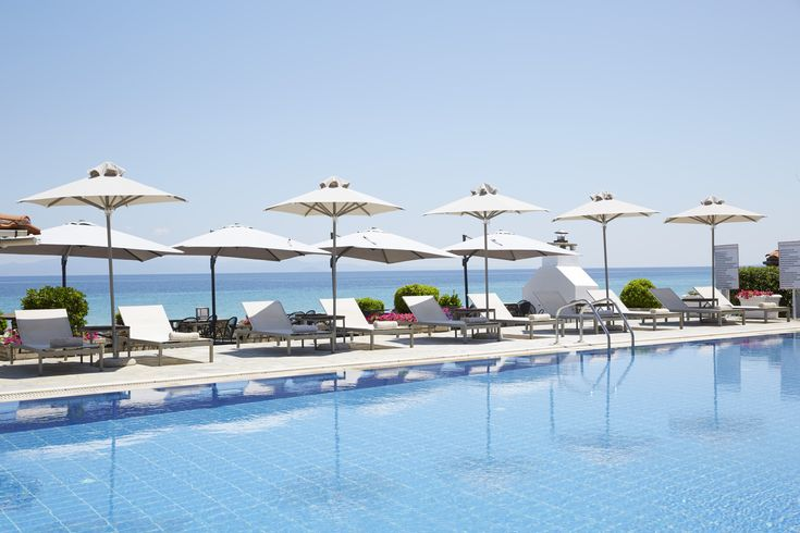 Fancy our hotel pool? The #AmmonZeus is among the very few hotels in #Kallithea with a swimming pool located right in front of the beach. That way it is now easier than ever for our guests to combine a deep in both the swimming pool and the bright blue sea. http://ammon-zeus.gr #AmmonZeus #LuxuryHotel #Chalkidiki