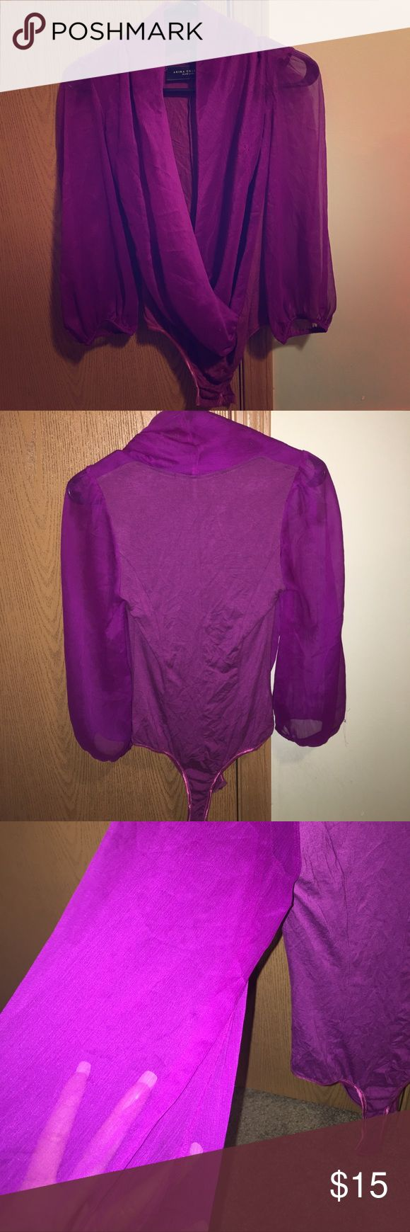 Vibrant purple body suit Nice open neck line *clings to the chest with flowy arms *perfect for a woman of any bust size *snaps at the bottom for easy take off and on *can be paired with jeans or a nice skirt *last photo shows transparency AKIRA Tops Blouses