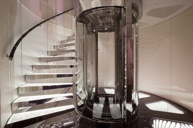 Circular Glass Elevator And Winding Staircase Designs