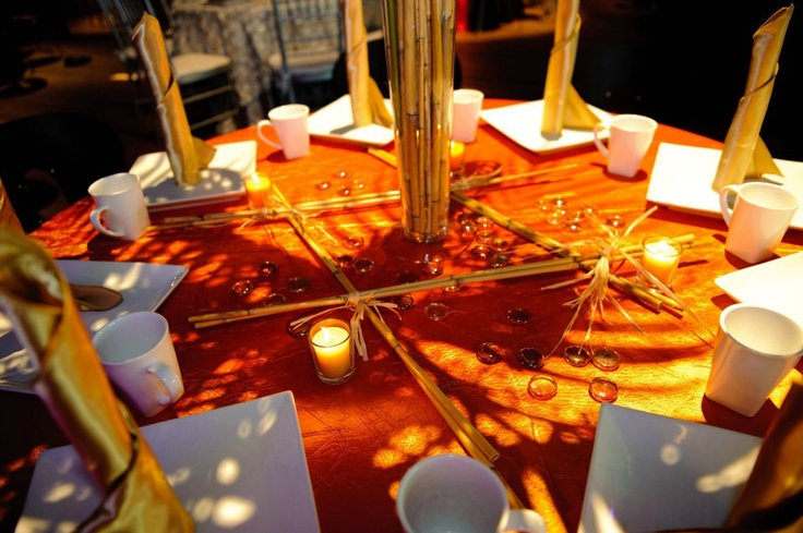 Love this candles bamboo and orange pebbles wedding for Orange centerpieces for tables