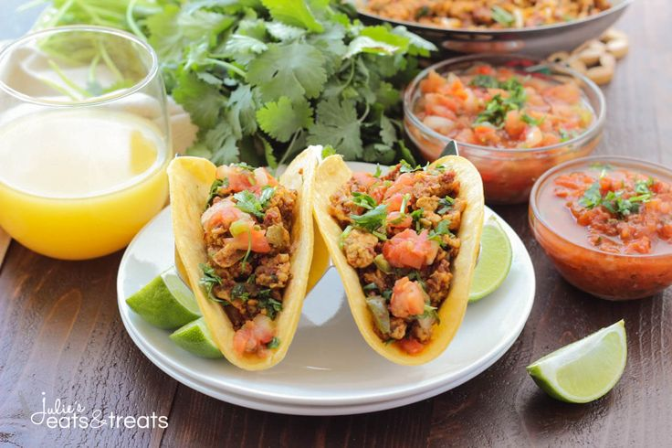 Chorizo Breakfast Tacos ~ Soft scrambled eggs mixed with chorizo and vegetables, then stuffed into a corn tortilla with beans. Topped with some salsa, pico de gallo and cheese. This is a breakfast dish you won