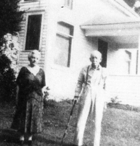 Almanzo and Laura Ingalls Wilder outside the house they built on Rocky Ridge Farm in Mansfield, Missouri.