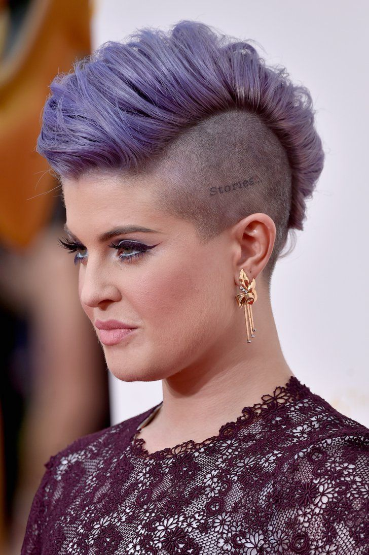 Pin for Later: See Every Dazzling Hair and Makeup Look From the Emmys Kelly Osbourne Kelly pumped up her mohawk haircut into a pompadour look for the Emmys red carpet, putting her edgy scalp tattoo on display.