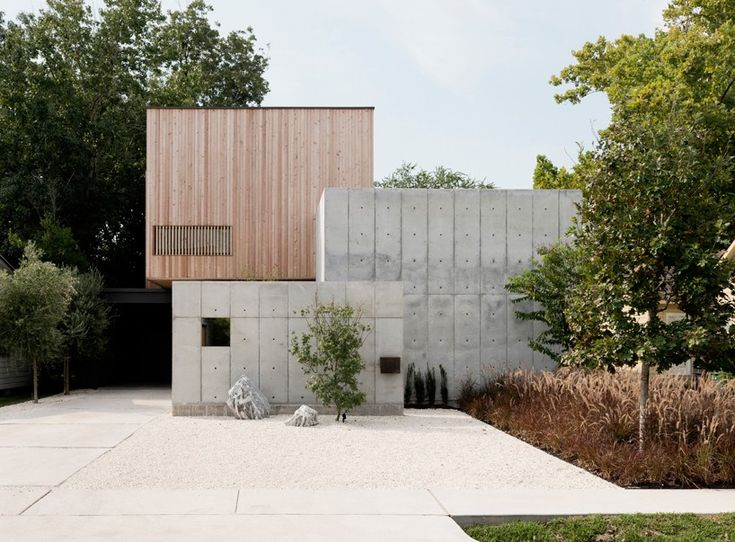 christopher robertson overlaps concrete + timber volumes in refined texas home