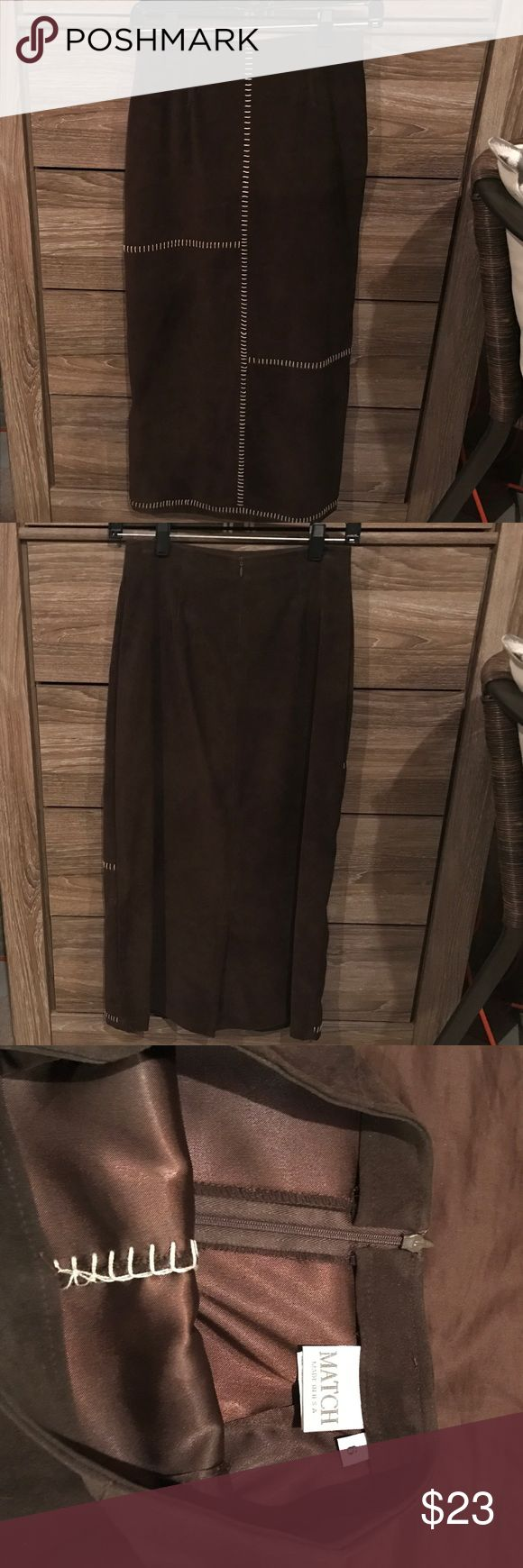 Long soft dark chocolate brown pencil skirt A super soft pencil skirt with tan stitching going down the front. Has a small slit in the back and a small zipper in the back to zip up around the waist. I love this skirt with a tan blazer. Only worn once. Very good condition! Skirts Pencil