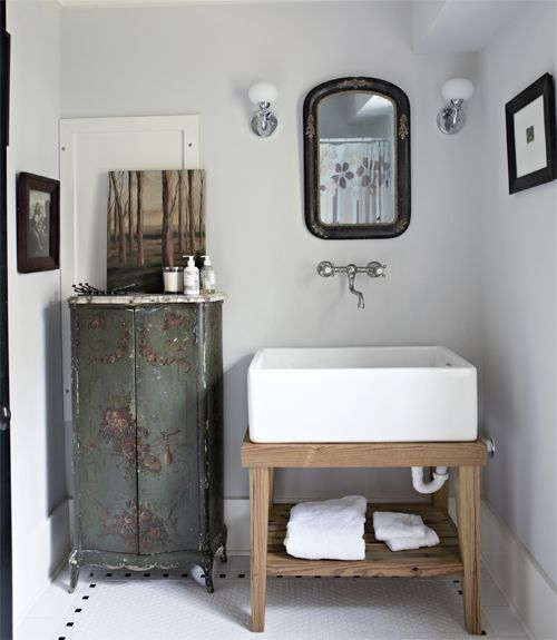 MY STYLE :: Plentiful Surface Area :: To make guests feel at home, interior designer Bunny Williams suggests providing a handy surface for toiletries. A cabinet, table, or stool in the bathroom guarantees visitors won't have to balance their Dopp kits on the edge of the sink in the bathroom. :: GOOD IDEA: Like color scheme. | #bathroom #countryliving #neutrals #whites