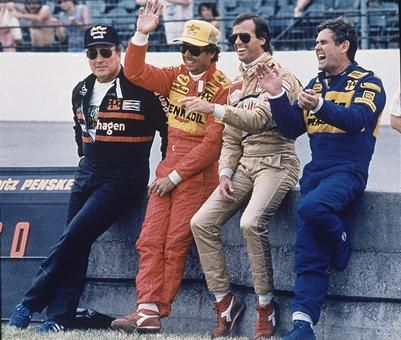 Indy 500 champs (from left) A.J. Foyt, Rick Mears, Danny Sullivan and Al Unser joke with the crowd as they stand along the pit wall at Indianapolis Motor Speedway in 1988.