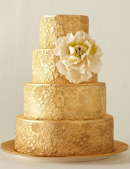 This gold embossed wedding cake has great detail and carries a certain elegance and glamour.